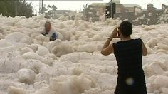 The extreme weather has provided some spectacular images on the Sunshine Coast with foam being stirred up by the wild waves hitting Maroochydore.