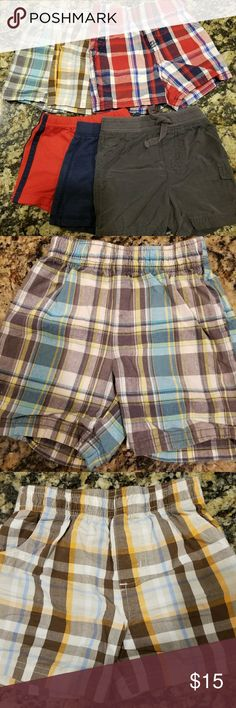6pc. Bundle/Lot Baby Boy Shorts | Plaid, Cargo 6pc. Bundle/Lot Baby Boy Shorts  1x Carter's Plaid Short (Grey, Blue, Yellow & White) 1x Garanimals Plaid Shorts (Brown, Orange, Blue & White) 1x Circo Plaid Shorts (Red, Blue & White) 1x Carter's Red w/ Double Blue stripes Down Sides 1x Jumping Beans Dark Blue Shorts 1x Jumping Beans Dark Grey Shorts Bottoms Shorts