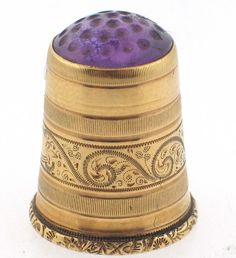 Victorian c1890's 14k gold hand engraved thimble with carved amethyst in the top......