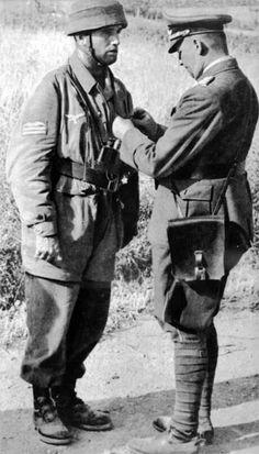 A Fallschirmjäger receives a decoration. Date/location unknown.