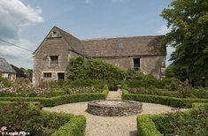 Sculpted: The home includes well-kept gardens, and an outbuilding used for parties...