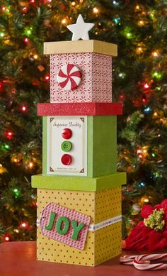 """Use Mod Podge Sparkle and Dimensional Magic to create a stackable faux """"DIY Christmas tree"""" decoration that looks great for the holidays. Christmas Tree Light Up, Unique Christmas Trees, Homemade Christmas Decorations, Simple Christmas, Holiday Crafts, Christmas Time, Christmas Ornaments, White Christmas, Christmas Boxes Decoration"""