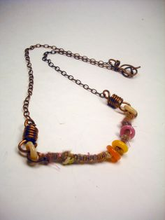 Upcycled Copper Necklace with Coiled Wirecore Handspun from Handspun Jewelry Collection. $25.00, via Etsy. Metal, fiber, fleece, felt, brass
