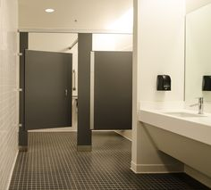 Ironwood Manufacturing laminate toilet partitions and Zero Sightline bathroom doors.