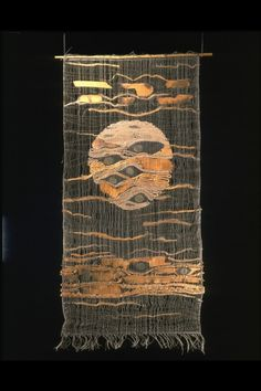 Tadek Beutlich, Moon.  1963. Woven ramie and camel hair with insertions of honesty seeds, x-ray film and charred wood veneer.