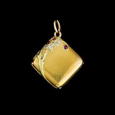 FABERGÉ~ An antique Russian gold locket by Fabergé, with rose-cut diamonds and cabochon rubies.