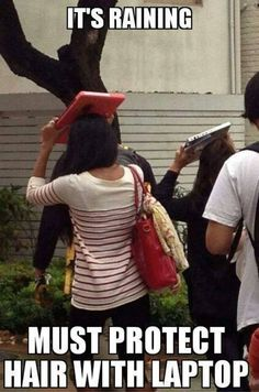 It's raining, must protect hair with laptop!