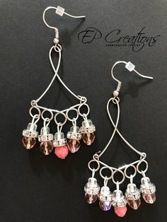 Handcrafted silver chandelier earrings with pink Czech glass beads and crystal metal beads Unique hand wire wrapped silver chandelier earrings with beautiful pink Czech glass beads and crystal spacers. Earrings are designed for special occasion wardrobe as well as for daily use.