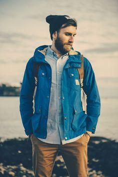 Shop this look on Lookastic:  http://lookastic.com/men/looks/black-beanie-grey-long-sleeve-shirt-blue-parka-brown-chinos/7889  — Black Beanie  — Grey Long Sleeve Shirt  — Blue Parka  — Brown Chinos