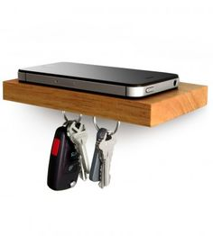 Phone. Wallet. Keys. Sunglasses. Keep all your essentials on this small floating shelf with a magnetic underside.    Plank. Hold the phone.  http://ilovehandles.net/products-page/iphone/plank/