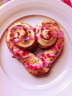 Valentine Heart Shaped Cinnamon Rolls with Pink Icing.