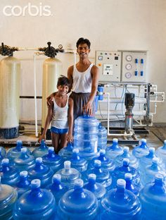 Father and Son in family run clean drinking water production plant Water Issues, Rich Image, Music Licensing, Father And Son, Photo Library, Drinking Water, Royalty Free Photos, Sons, Plant