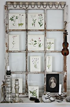 The Vintage Touch    A simple chippy vintage window becomes a focal point in the room...with touches of aged botanical prints and touches of days gone by it can warm your heart.