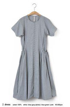 Jurgen Lehl dress.  Neck and closure detailing, gathered pockets.