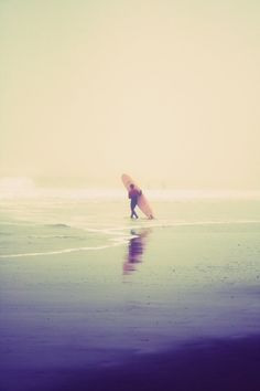 longboard on foggy beach