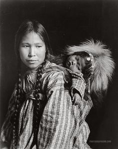 Madonna of the North. Inuit woman with papoose on back. Nome, Alaska 1912