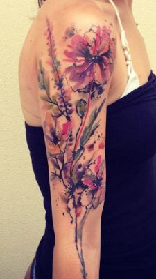 Ondrash Tattoo - placement - larger flower near the front of the shoulder...not as far down the arm