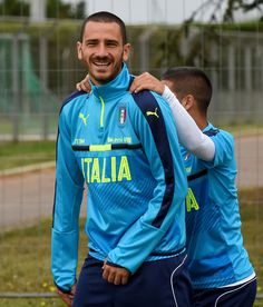 "Leonardo Bonucci (L) and Lorenzo Insigne of Italy joke during the training session at ""Bernard Gasset"" Training Center on June 18, 2016 in Montpellier, France."