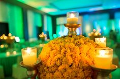 Marigolds are quintessential to Indian weddings. A modern take on marigold table centerpieces.  #AuraAffaire #AuraAffaireWeddings