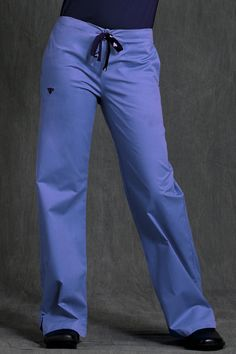 Med Couture Women  Signature Scrub Pant  Ceil/Navy Subtle stitching for added fashion detail. Pen pockets, velcro accents and added invisible pockets inside of large pockets for added functionality. Fashion, function, and comfort all in one! A basic pair of drawstring pants from Medcouture will keep you in comfort and style throughout your work shift.