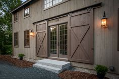 Barn door entry. Grantham Lakehouse Barn Home - Yankee Barn Homes