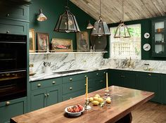 U.K. design firm deVOL Kitchens describes the daring cabinet color used in their Peckham Rye Kitchen as a cross between emerald and racing green.