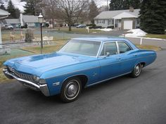 1968 chevy impala -- my first car...I called it the blue bomb.  I learned how to work on a car while I owned this one, I was always broke down on the side of the road....lol