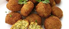 Falafel Day is a day dedicating to the celebration of one of Israel's favorite foods, falafel. A street food which is an Israeli obsession, falafel is a Greek Recipes, Veggie Recipes, Vegetarian Recipes, Cooking Recipes, Baked Falafel, Falafels, Chickpea Patties, Vegetarian Meatballs, Vegetarian Meals
