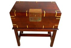 """A handsome mahogany-stained wood humidor with brass accents on a stand. Trunk is lined with light brown velvet and is removable from the stand. Trunk only, 19""""L x 11""""W x 7.75""""H, stand only, 20.25""""L x 12""""W x 14.25""""H."""