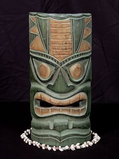 """Here is a hand carved Tiki mask with a beautiful finish. This Polynesian Tiki mask was hand carved with great attention to details (ready to hang!). Perfect for in between photos of your loves Measurement: 12"""" by 5 inches Tiki: Polynesian Tiki Perfect forest decoration!"""