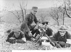 """Members of the  Volkssturm training with experienced soldiers from the """"Grofldeutschland"""" Division."""