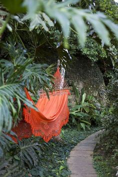 Orange hammock in some foliage. Get me a book stat!