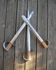 Cardboard swords using wrapping paper roll inner. Clever!