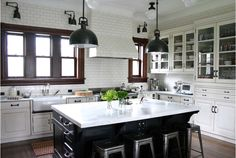 This kitchen is magical, too. Clean and crisp white cabinetry, stand-out island, glass doors on the upper cabinets, SO fabulous.