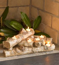 "Dress up an unused fireplace with our elegant logs candle holder. Faux-wood, resin ""logs"" look great in the hearth. Add your own tea light candles and you'll have the romantic ambiance of a fire without the heat or mess. Fireplace Candelabra, Fireplace Candle Holder, Log Candle Holders, Fireplace Mantels, Fireplace With Candles, Logs In Fireplace, Fireplace Ideas, Fireplaces, Decorative Fireplace Logs"