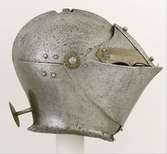 Armet Date: ca. 1490, with later additions Geography: Milan; said to have been found in Norfolk Culture: Italian, Milan Medium: Steel, brass Dimensions: H. 10 1/4 in. (26 cm); W. 8 1/2 in. (21.6 cm); D. 12 7/8 in. (32.7 cm); Wt. 6 lb. 7 oz. (2903 g)