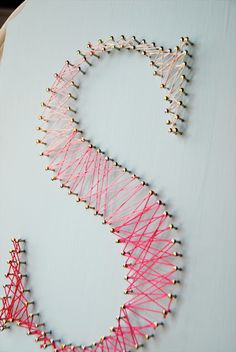 Honey + Fitz string art! Use rainbow floss or gimp. Hang on picture wall. Place on poster board.