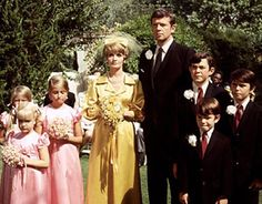The very first episode of 'The Brady Bunch' series introduced us to Carol Martin and Mike Brady as they joined their two families to make one big bunch. The new Mrs. Brady wore a yellow shirtdress and a matching bow-tipped veil.