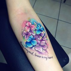 """I really love this small tribute tattoo. Colorful hydrangea with the quote """"Always on my mind... Forever in my heart"""""""