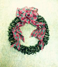 #Handmade, #Metal, #Recycled, #Ribbon, #Steel, #Wreath Being tired of the same old traditional holiday wreath this past year I did this for the door. Old rusted, twisted steel ribbon style farm fencing fashioned into a wreath adorned with a handmade bow.