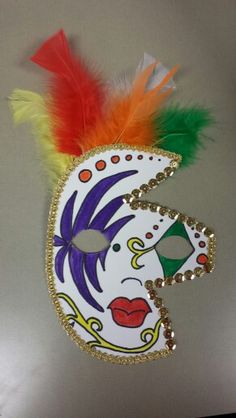 Mardi Gras mask made from poster board and simple craft supplies for a classroom unit.
