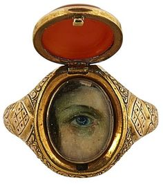 """<b>Lover's Eye</b> <br /> 19th century ring <br /> 15K yellow gold, bi-color agate, concealed miniature painting of a right blue eye <br /> agate: 3/8""""w x 1/2""""h; size: 6.75 <br />"""