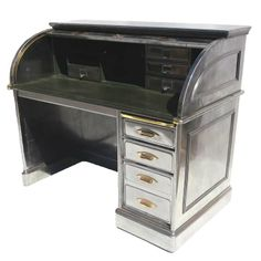 Polished Steel Roll Top Desk | From a unique collection of antique and modern desks at http://www.1stdibs.com/furniture/storage-case-pieces/desks/