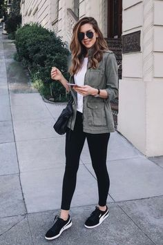 Military jacket and tights with sneakers concert outfit idea #casualwinteroutfit