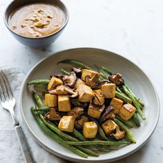 "This simple baked tofu with peanut sauce is a one-pot wonder; the simple ""stir-fry"" bakes in the oven, making cleanup a snap. Serve over leftover rice."