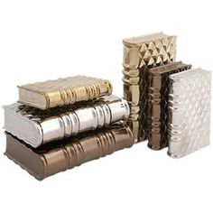 "Add a shimmering touch to your entryway console table or living room mantel with this eye-catching book decor set, crafted from ceramic and featuring metallic finishes.  Product: 3 small and 3 large book decorConstruction Material: CeramicColor: Gold, silver and copperDimensions: 2"" H x 9.5"" W x 6.5"" D (large)"