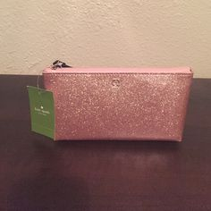 """NWT Kate spade cosmetic bag NWT Kate spade cosmetic bag in rose gold. Absolutely beautiful with a slip on the inside and very roomy. It is approximately 4"""" tall 8"""" long and 2.5"""" wide. No trades. kate spade Bags Cosmetic Bags & Cases"""
