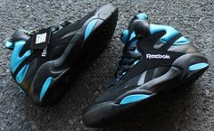 d6c425ecd980e ... the Reebok Shaq Attaq Black Blue sees the return of an OG. A black  leather upper is contrasted with pebbled paneling