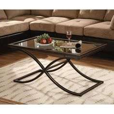 <br><li>Bring style and sophistication to your home with this Vogue Cocktail Table<li>Table features durable metal frame with a tempered glass top<li>Distressed finish makes this table an elegant addition to complement any living room decor