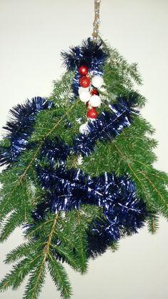 kersttak uit eigen tuin versierd
